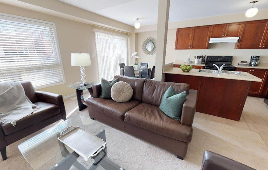 Living Room / Kitchen Free WiFi Fully Furnished Apartment Suite Oakville